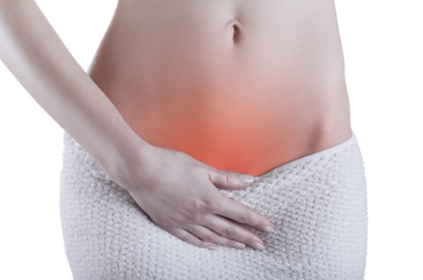 Close up of a woman's abdomen with menstrual pain isolated on white background